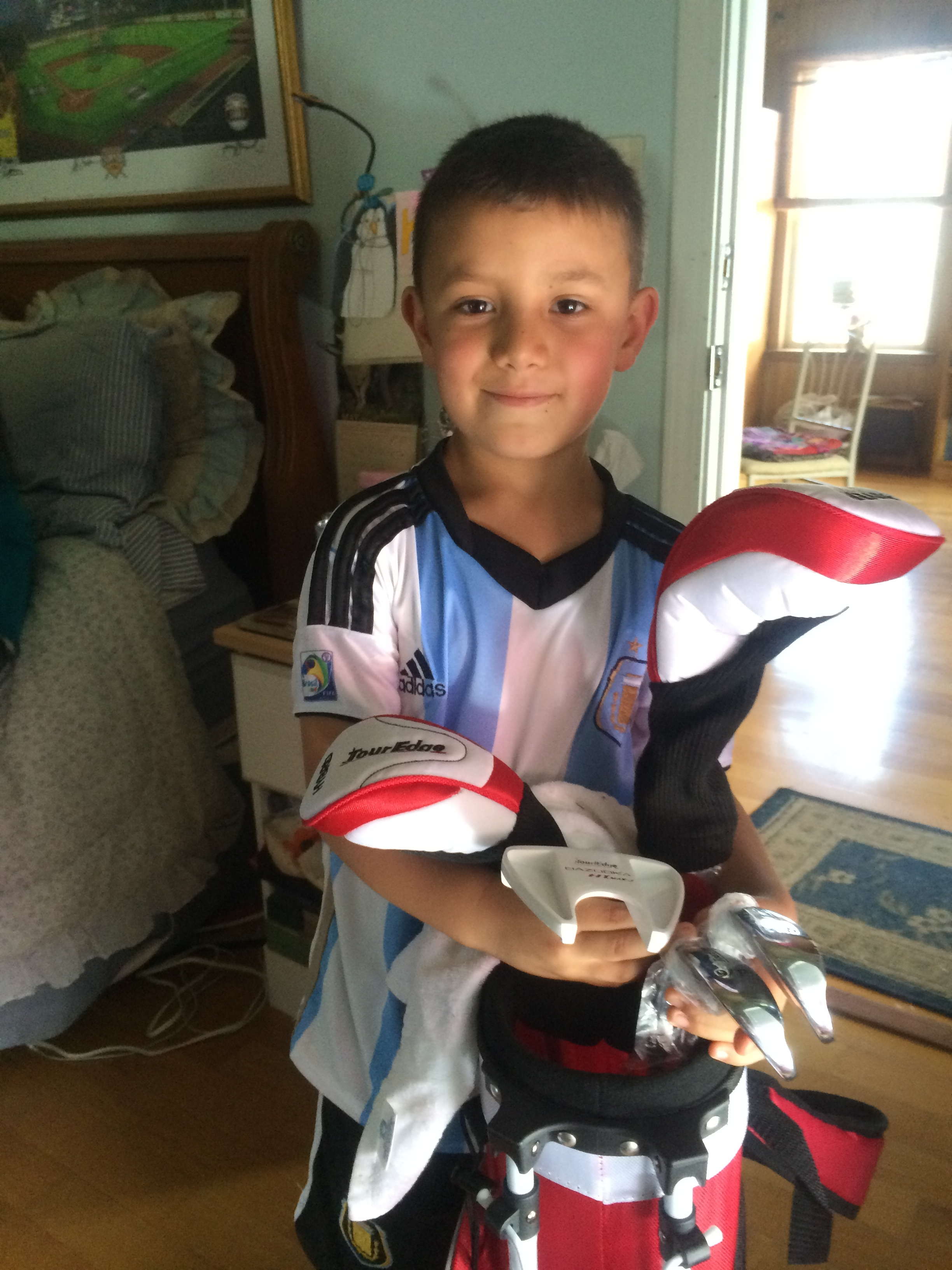My grandson, Michael, with new golf clubs
