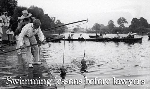 This father in Guatemala has a lasso around the necks of his two children and is teaching them to swim.