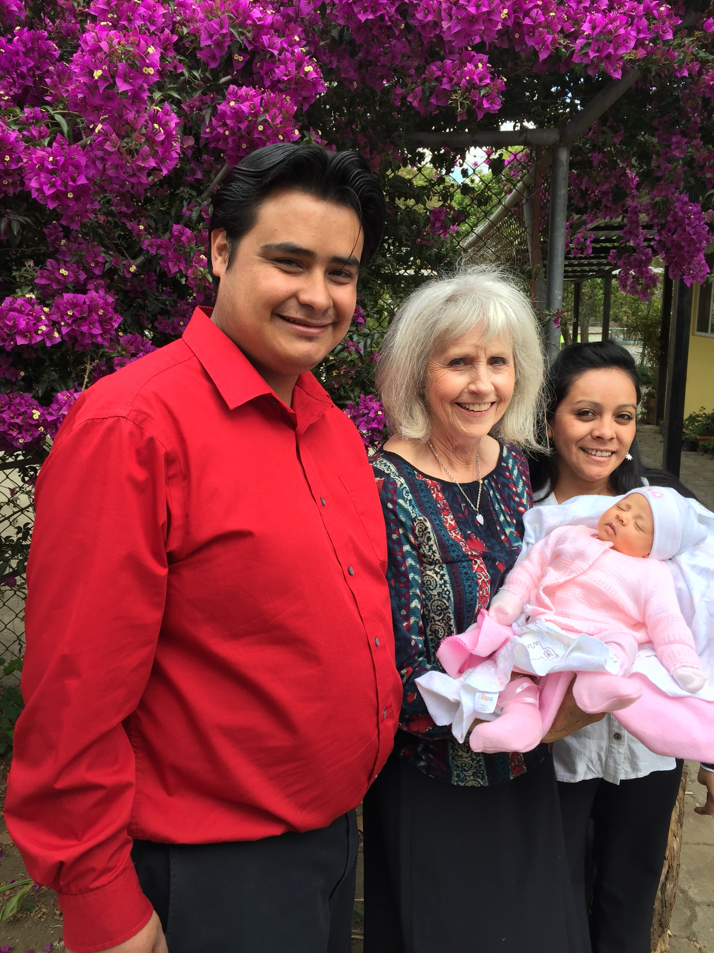 Mario, Mariella and Grandma with baby Emily.