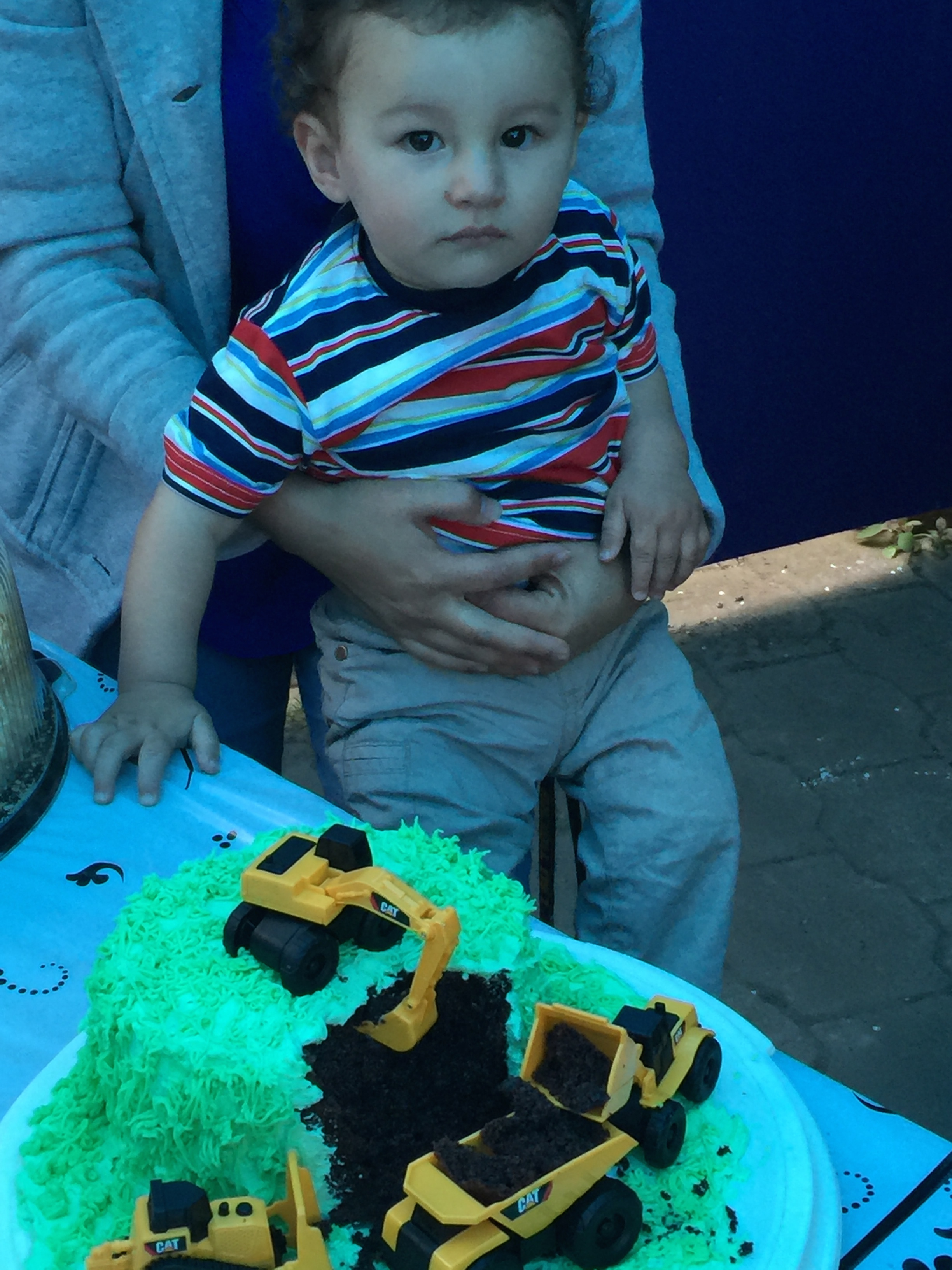 Our grandson, Robbie, and his 1st birthday cake. A construction site!
