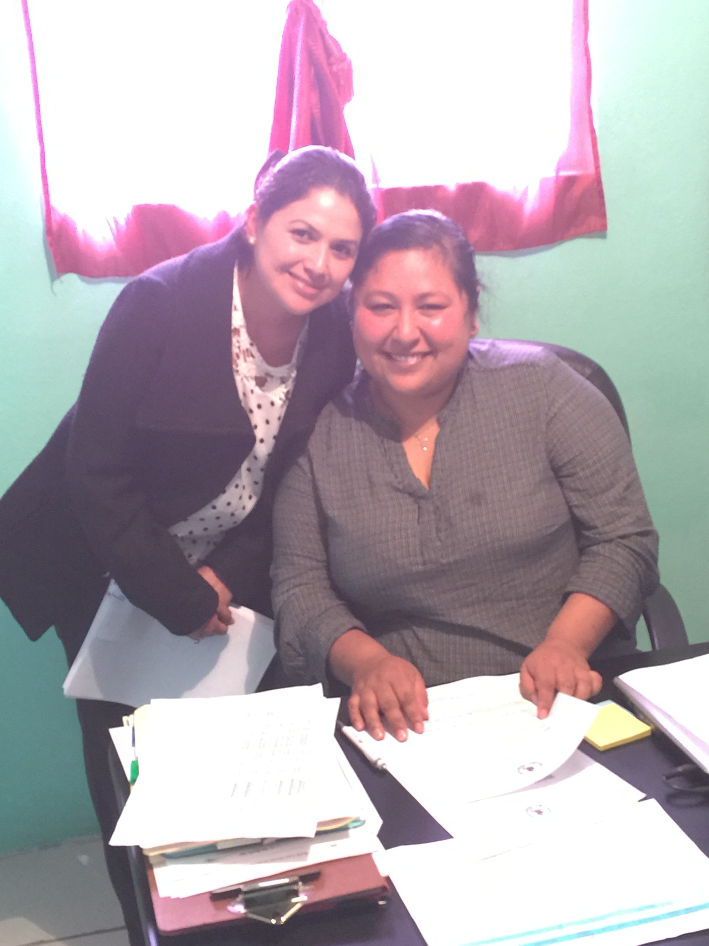 Lily and Analy doing paperwork