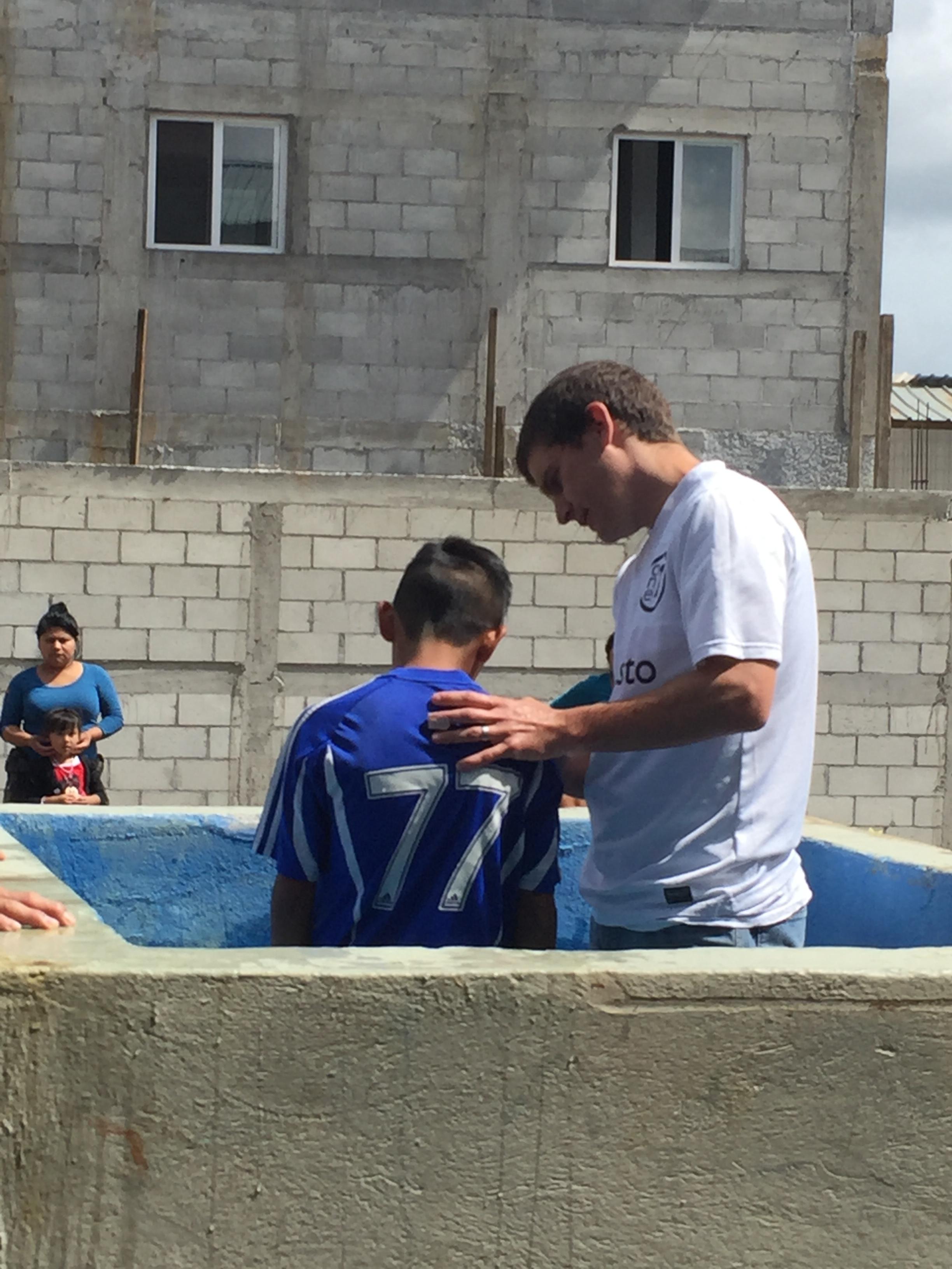 Adam baptizing one of the boys