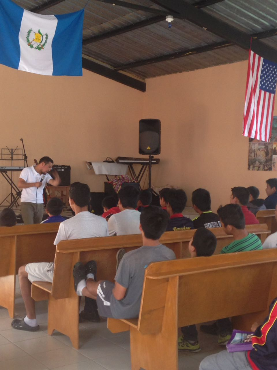 Visiting pastor ministering to the boys
