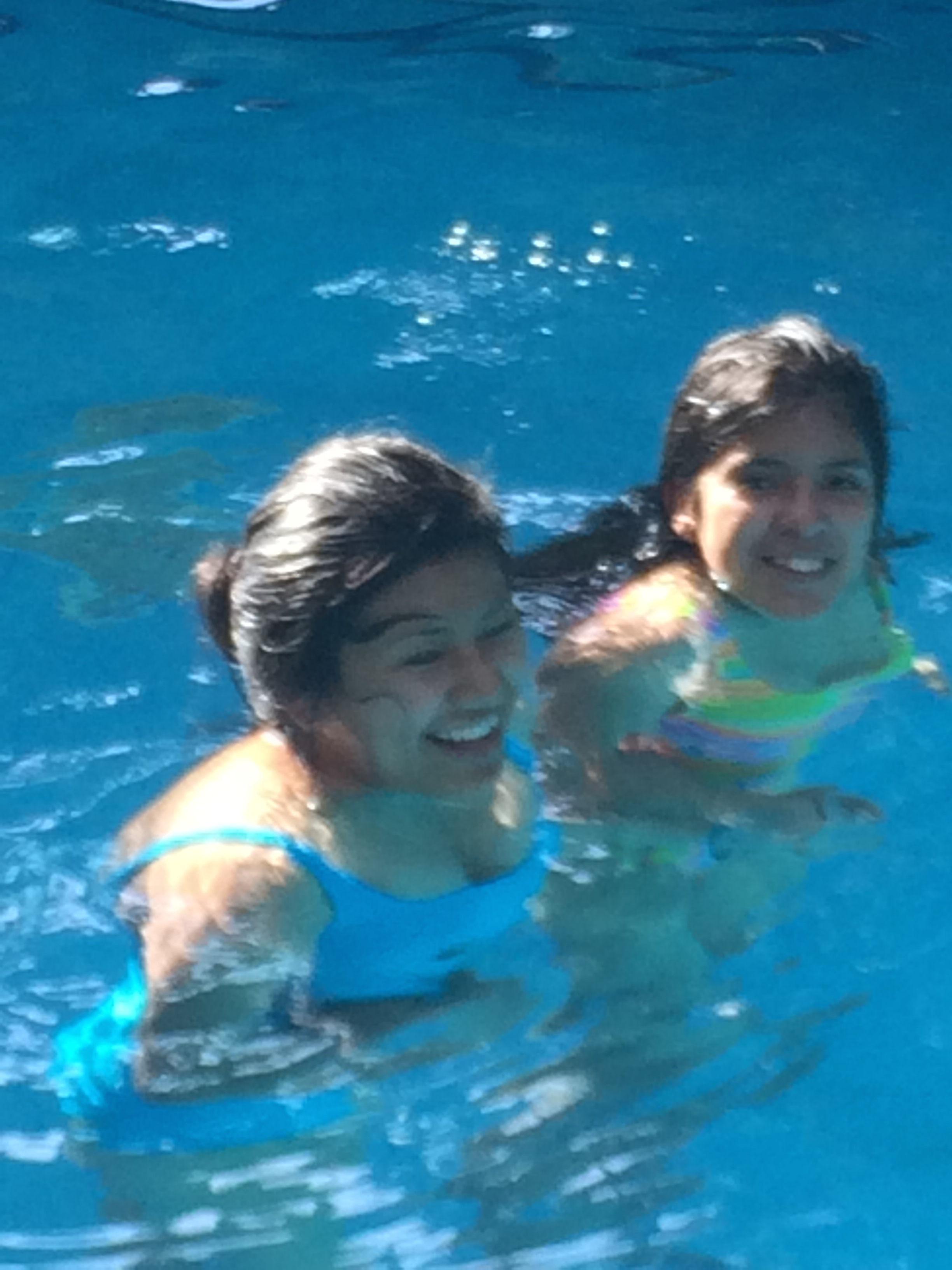The girls love the pool at the hotel